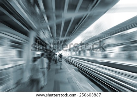 blurred woman stand waiting metro train at  station background, transportation in urban city - stock photo