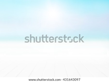 Blurred wood floor with white blue surfing wave background. Blue water and sky bright. Nature wallpaper blur of sea daytime. Focus to wooden in the foreground. Timber pattern texture stage. - stock photo
