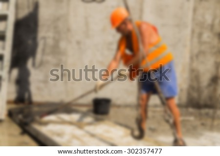 Blurring background building, people are working on the construction site. - stock photo