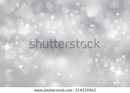 Blurry abstract bokeh lights on grey background with sparkle. - stock photo