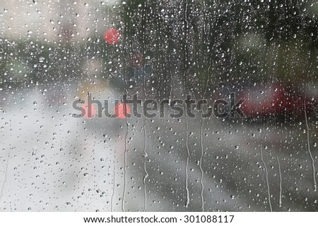 Blurry backdrop. Rainy window. View from window to cityscape. Summer autumn rain. Weather template.   - stock photo