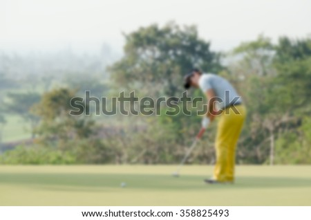 Blurry background man playing golf - stock photo