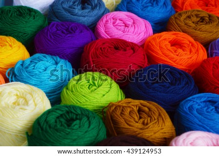 Blurry background of colorful knitting. View from above of colorful knitting. - stock photo