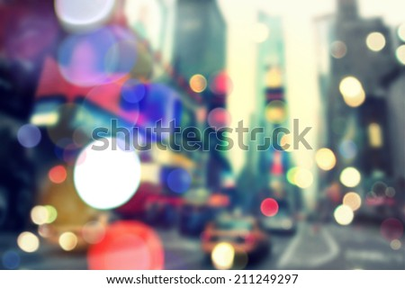 Blurry bokeh background of vintageTimes Square in New York - stock photo
