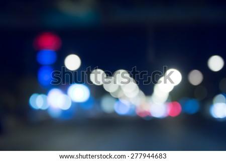 Blurry car lights bokeh - stock photo