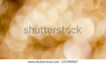 Blurry Christmas background abstract with defocused golden lights and shadows. - stock photo