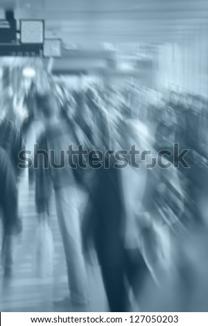 Blurry Crowd - People in a Hurry - in Shades of Blue - stock photo