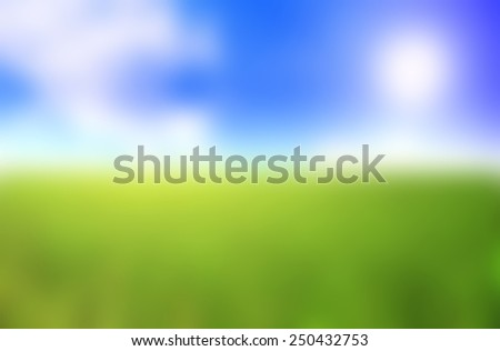 blurry green grass and sky background - stock photo