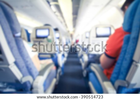 blurry image of interior of airplane with passenger - stock photo