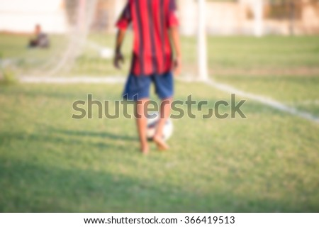 blurry,motion blur,Children without shoes Playing football - stock photo