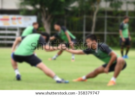 blurry,motion blur.players playing football,Stretching(soccer) - stock photo