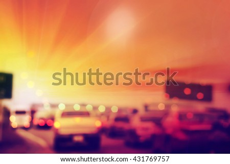 Blurry of car in Toll collecting on the expressway at sunset - stock photo