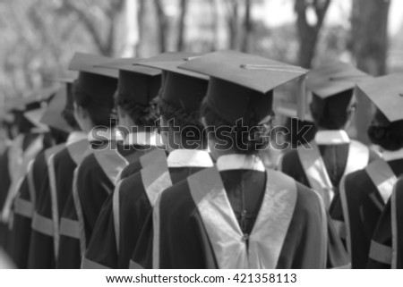 blurry of Graduates are walking the line to get a diploma and selective focus. - stock photo
