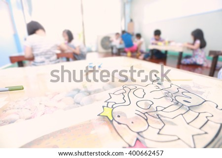 Blurry of  happy children doing artwork. . defocused  and soft color toned. - stock photo