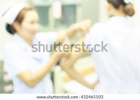 Blurry of nurse and patient in treatment room.Vaccination for women in vaccine room.Medical concept. - stock photo