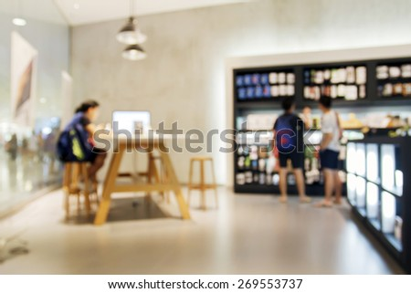 Blurry of people walking and test mobile phone shop at  shopping center/supermarket/mall - stock photo