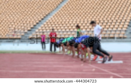 Blurry of Sprinter getting ready to start the race - stock photo