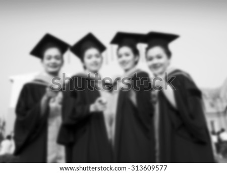 blurry of Students with congratulations graduation celebrating and happy girl student on black/white tone. - stock photo