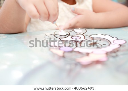 Blurry of  young girl doing artwork with color . defocused  and soft color toned. - stock photo