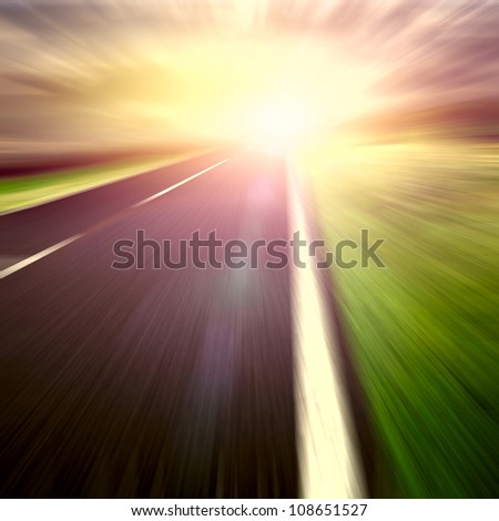 Blurry road and blurry clouds and sun set - stock photo