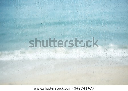 Blurry sea in the rain ( koh samui - Thailand ),View through the window with shallow depth of field composition. - stock photo