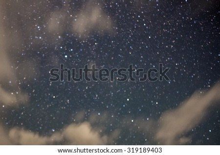 blurry star on sky background - stock photo