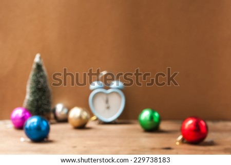 Blurry with out focus ,abstract background to memory of Christmas ,Christmas decorations retro clock  on wooden background - stock photo