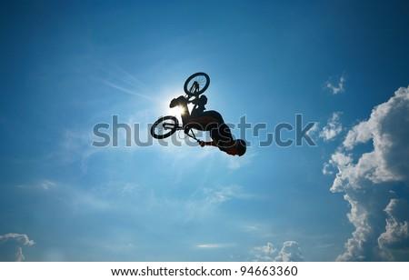 "BMX rider performing air trick ""back-flip"" - stock photo"