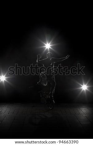 BMX rider performing BMX flatland trick - stock photo