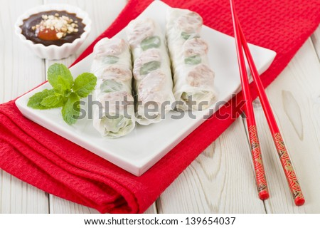 Bo Bia - Vietnamese fresh summer rolls with Chinese sausage, jicama, carrots, lettuce, egg and dried shrimp served with hoisin and peanut dip. - stock photo