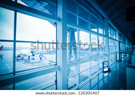 board a plane with airport window outside scene - stock photo