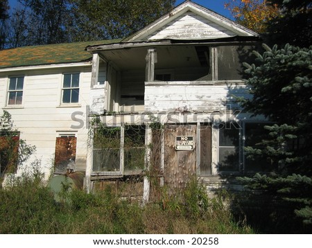 Boarded up house. - stock photo