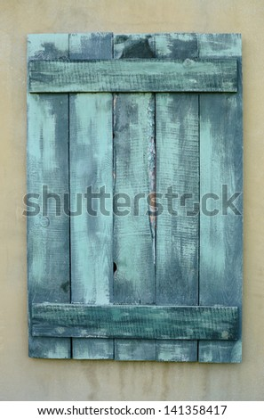 Boarded up window of old house - stock photo