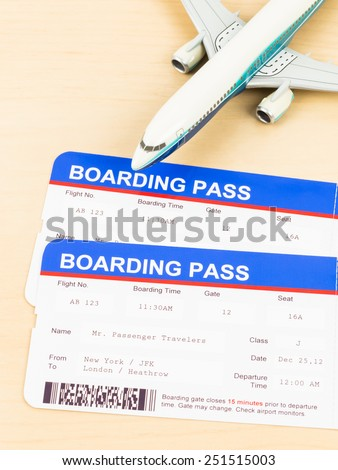 Boarding pass and plane model - stock photo