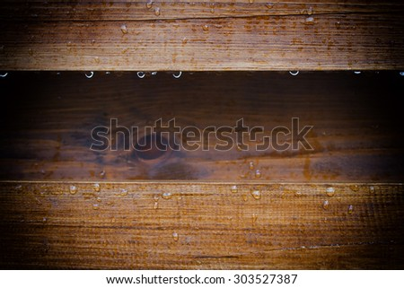 boards with a gap between them with raindrops - stock photo
