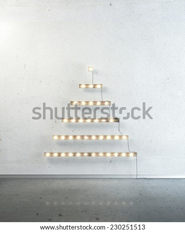 Boards with lightbulb in the form of a Christmas tree on a wall. Happy new year and Christmas. - stock photo