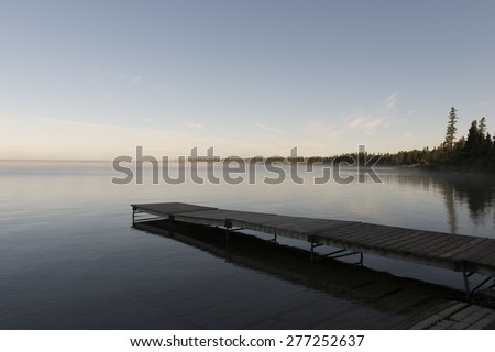Boardwalk in a lake, Lake Audy Campground, Riding Mountain National Park, Manitoba, Canada - stock photo
