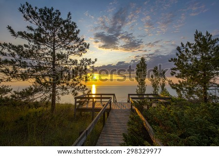 Boardwalk Leading to a Lake Huron Sunset - Pinery Provincial Park, Ontario, Canada - stock photo