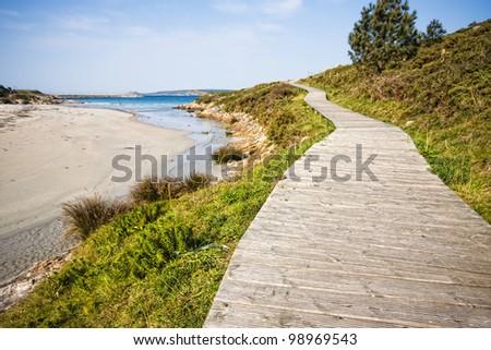 Boardwalk on the beach in Muxia, La Coruna, Spain - stock photo