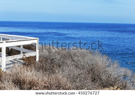 Boardwalk overlooking the shore of La Jolla Cove beach in San Diego, California USA background - stock photo