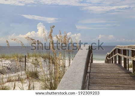 Boardwalk to White Sand Florida Beach - stock photo