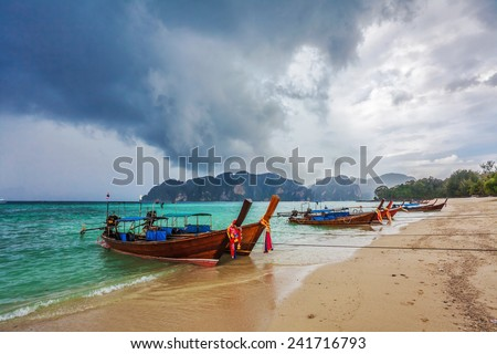 Boas in the tropical sea under gloomy dramatic sky. Thailand  - stock photo