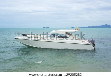 Boat - a speed boat on blue water - stock photo