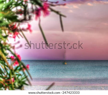 boat alone in the sea at dawn. Shot in Sardinia, Italy - stock photo
