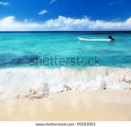 boat and Caribbean sea - stock photo