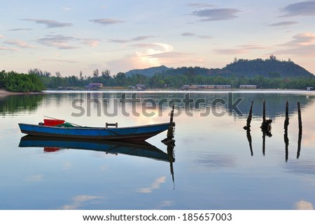 Boat and reflection, calm and peaceful view Kota Kinabalu Sabah Borneo Malaysia - stock photo