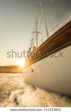 Boat and the sunset - stock photo