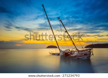 Boat and Yacht abandoned with a beautiful sunset in the east of the country. - stock photo