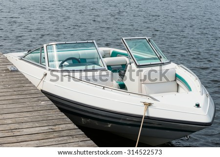 Boat at a dock - stock photo