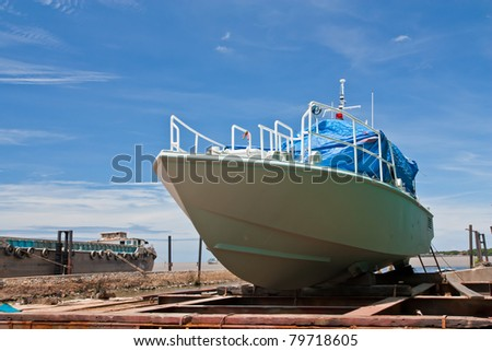 Boat at a dock for painting and repair  - stock photo